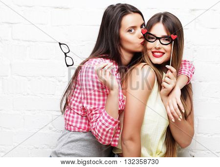 two young women  with party glasses taking selfie