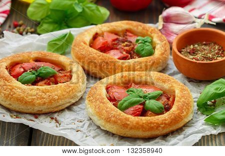 Homemade Pie Of Puff Pastry With Tomatoes, Basil And Spices. Mini Round Tomato Tart. Rustic Style
