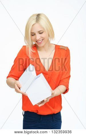 Present. woman in orange opening present or gift