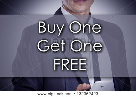 Buy One Get One Free - Young Businessman With Text - Business Concept