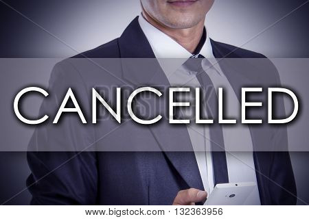 Cancelled - Young Businessman With Text - Business Concept