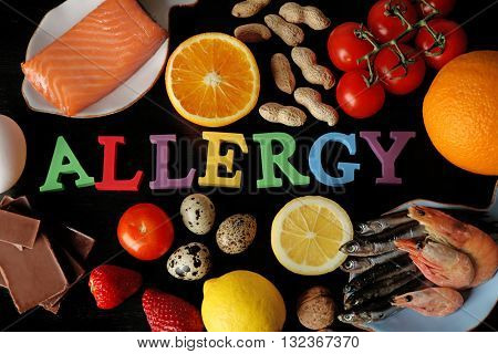 Set of allergic food on black wooden background
