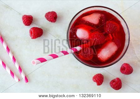 Raspberry Fruit Drink In A Glass With Straw, Overhead View On A White Marble Background