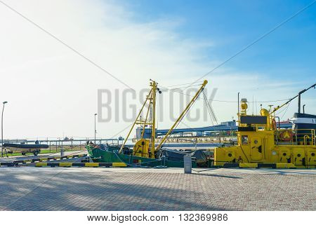Dry Cargo Vessel And Boat In Port Of Ventspils