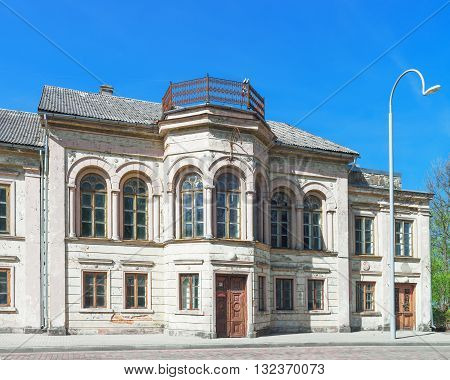 Facade Of Old House In Ventspils Of Latvia In Spring