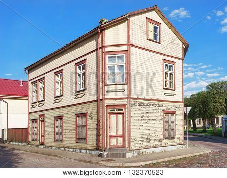 Old Wooden House In Ventspils Of Latvia In Spring