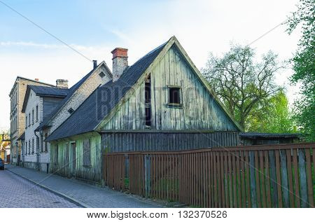 Old Wooden House With Wooden Fence In Ventspils In Latvia
