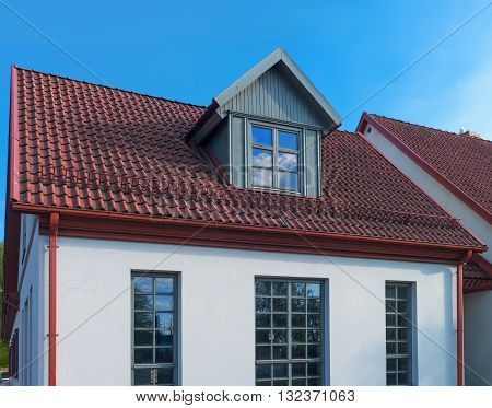 White Painted House With Red Roof In Ventspils