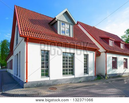 White Painted Houses With Red Roof In Ventspils
