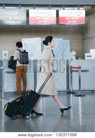 Asian Female Air Flight Attendant At The Incheon International Airport