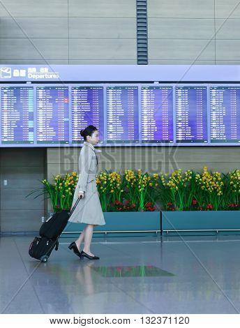 Asian Female Flight Attendant At International Airport Of Incheon