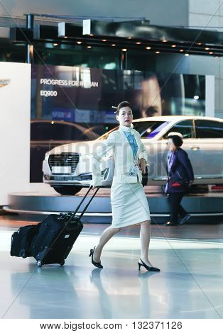 Asian Female Flight Attendant At The International Airport Of Incheon