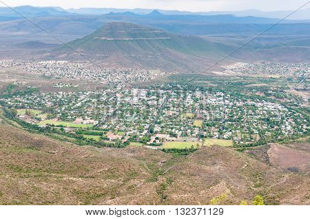 An aerial view of Graaff Reinet as seen from the road to the Valley of Desolation viewpoint. The town lies in a horseshoe bend of the Sundays River