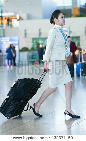 Asian Female Flight Attendant In The International Airport Of Incheon