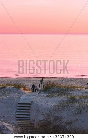 Couple At The Beach At Sunset In Ventspils