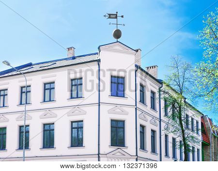 Facade Of An Old House With Weather Cock In Ventspils