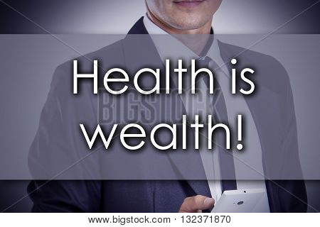 Health Is Wealth! - Young Businessman With Text - Business Concept