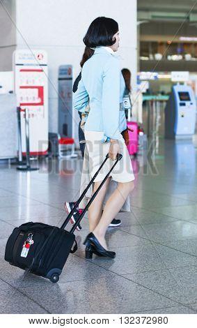 Asian Flight Attendant In International Airport Of Incheon