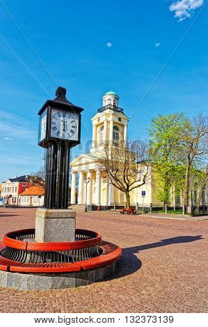 Clock And Lutheran Church Of Saint Nicholas In Ventspils