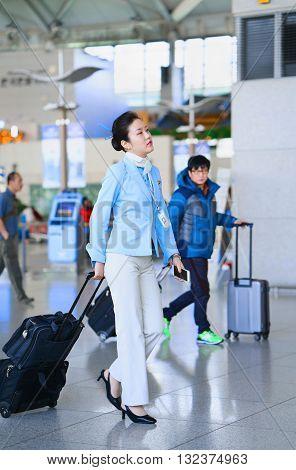 Asian Air Flight Attendant In International Airport Of Incheon