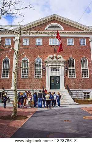 Lehman Hall And Tourists In Harvard University In Cambridge