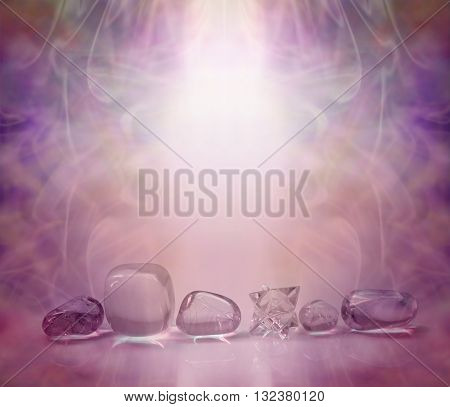 Magenta Healing Crystals - single row of clear crystals and a Merkabah, bathed in a magenta energy light with a beautiful wispy background and copy space
