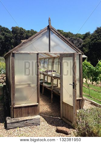 Wooden greenhouse in a garden - portrait orientation