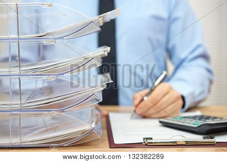 Many documents arranged in a file shelves paperwork and accounting