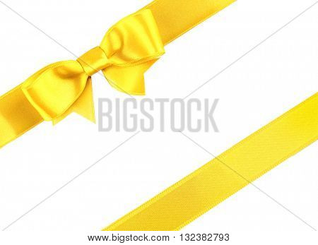 Yellow diagonal ribbons and bow, isolated on white