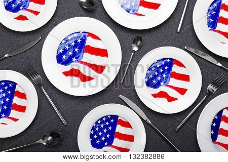 Dishes on black wooden background. American cuisine food concept