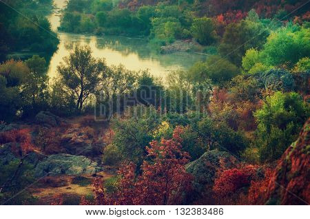 Rural autumn sunrise soft landscape with river and  colorful trees, seasonal background