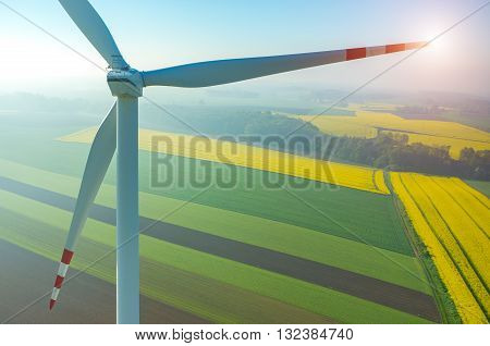 Sunset Above The Windmills On The Field