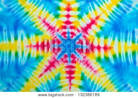 Blur fabric Tie dye bright colors texture background. Point of the star.
