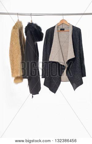 female coat clothing on hangers