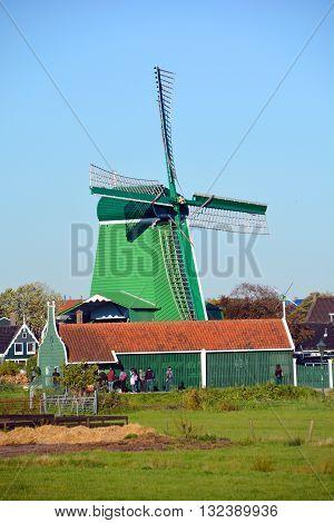ZAANSE SCHANS NETHERLAND OCTOBER 01 2015: Zaanse Schans is a neighbourhood of Zaandam in the municipality of Zaanstad in the Netherlands. It has a collection of well-preserved historic windmills