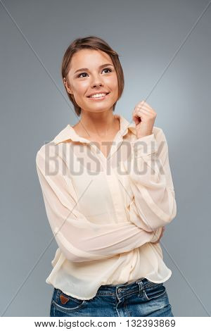 Cute young girl thinking about something isolated on the white background