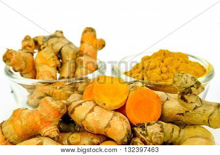 Turmeric (Curcuma longa L.) root and turmeric powder on white background.