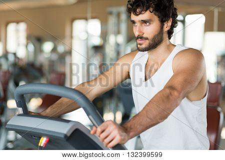 Man working out on a treadmill in a gym