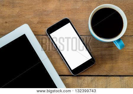 Office desk with blank screen smartphone cup of coffee and tablet . Flat lay photo.Top view with copy space