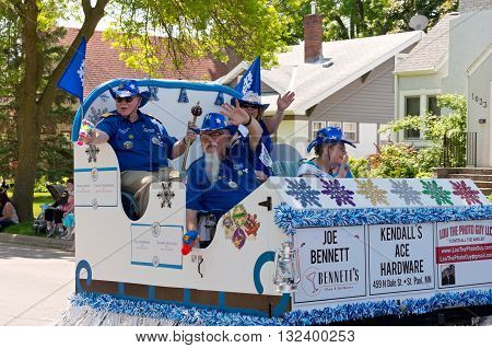 WEST ST. PAUL, MINNESOTA - MAY 21, 2016: St. Paul Winter Carnival Senior Royalty waves to crowd from float during annual West St. Paul Days Grande Parade  on May 21, 2016.