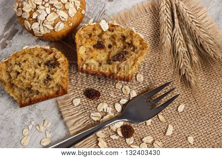 Fresh muffins with oatmeal baked with wholemeal flour and ears of rye grain concept of delicious healthy dessert or snack