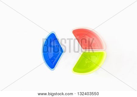 Multi-coloured disposable plastic isolated on white background