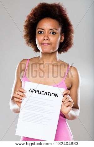 Suspicious Woman With An Application Form