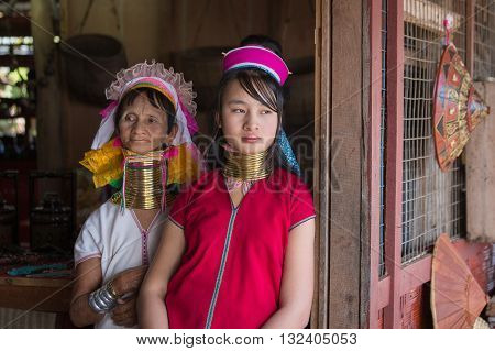 INLE LAKE MYANMAR - JANUARY 14 2016: Padaung Tribal women poses for a photo in Inle lake Myanmar Burma The Padaung-Karen long-necked tribe women are minority of Myanmar.