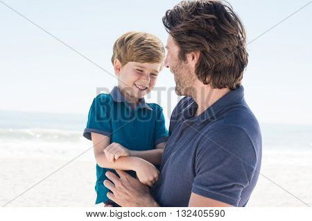 Child in father arms. Father day out with son. Father spending quality time with son.