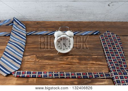 Working Hours Day Concept. Ties And Vintage Alarm Clock.