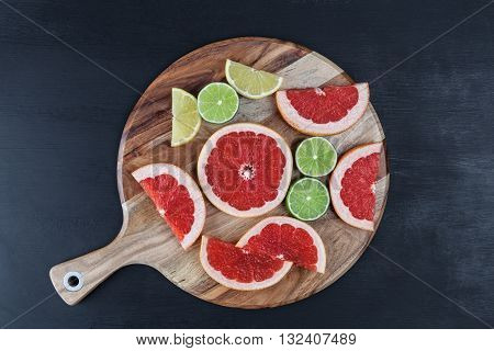 Slices Of Citrus Fruits On Chopping Board  Top View With Copy Space