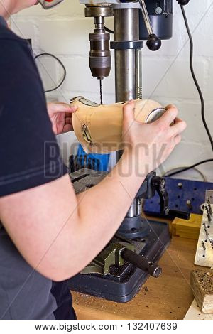 Technician Drilling Hole Into Prosthetic Limb