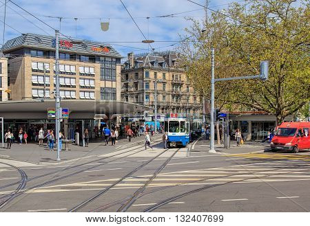 Zurich, Switzerland - 25 May, 2016: people. tram stops and buildings on Bellevue square. Zurich is the largest city in Switzerland and the capital of the Swiss canton of Zurich.