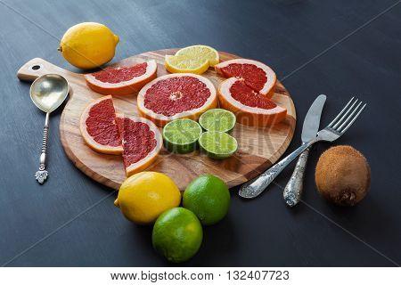 Citrus Fruits Arrangement With Vintage Silverware